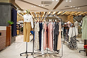 fashionable clothes in modern shopping mall