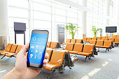 smart phone with smart home with modern airport hall