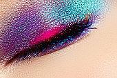 Close-up of beautiful female eye with marine colors eyeshadow