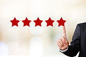 Businessman hand pointing five star, customer satisfaction concept, business background