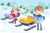 couple is snowmobiling