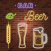 Retro neon Beer Bar sign on brick wall background