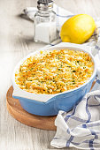 Casserole with crispy crumble, potato gratin, baked meat butter cheese dish, tasty homemade dinner