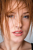 Beautiful Woman With Brown reddish Hair. Haircut. Hairstyle. Fringe. Professional Makeup. Focus on hair.