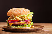 Fresh burger on wooden background