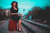 Fashionable woman waiting train at the railroad station