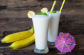Banana smoothies on old wooden