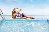 Woman relaxing at tropical resort