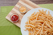 French Fries with tomato sauce and melted cheese