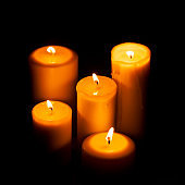 Candles burning in the night