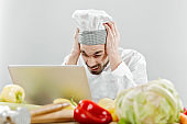 Kitchen chef looking recipes online and getting frustrated