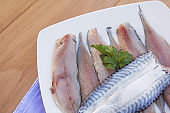 Fish fillets on wooden table