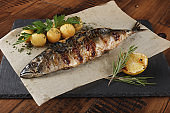Fried mackerel fish stuffed with lemon