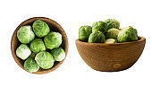Brussels sprouts cabbage in wooden bowl. Brussels sprouts cabbage isolated on a white background. Cabbage with copy space for text.
