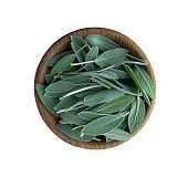 Fresh sage leaves in wooden bowl isolated on white background