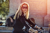 Businesswoman cycling in the city