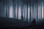 Alien and girl meet in the forest at night