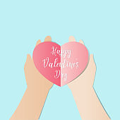 Hand holding Red hearts with Happy valentine's day text to giving for some one sweet love and romance concept, Paper cut style.