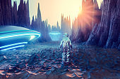 Astronaut on alien planet discovering glowing UFOs