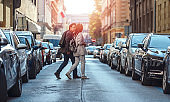 Couple crossing the street in the city