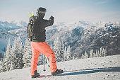 Backcountry Skier on Mountain Summit