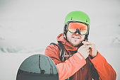 Happy Snowboarder Gearing Up Outdoor During Snowstorm
