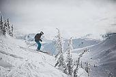 Skier in Action in Fresh Powder Snow