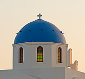 Classic view of blue dome church in Santorini