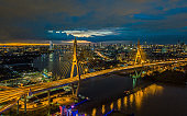 Aerial view sunset at Bridge over the Chao Phraya River Bangkok Thailand