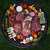 Delicious beef meat with vegetable on a barbecue grill
