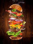 Big tasty burger with flying ingredients