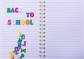 inscription back to school on a white notebook