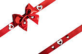 Red gift bow and hearts