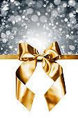 Golden gift bow on white