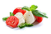 mozzarella with tomato and basil isolated on white
