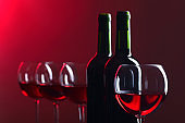 Bottles and glasses of red wine