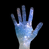hand and abstract universe