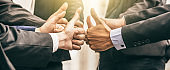 Business people group of hands making give thumbs up sign teamwork Join Hands Support Together successful Concept.