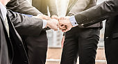 Business people group of hands making fist bump teamwork Join Hands Support together successful Concept.