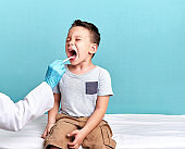 Pediatric doctor examining little patient