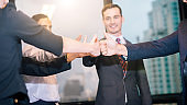 Team Business Partners Giving Thumb up Bump