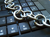 Chain on laptop keyboard. Block chain technology, Computer ban, internet ban. Addiction. Anti virus