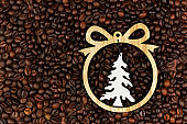 christmas tree toy on the background of coffee beans