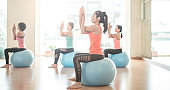 woman stretching on yoga ball in gym .do yoga