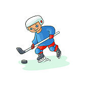 Happy little boy playing hockey, winter activity