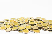 many coins currency Thai Baht lay down on white background. financial and saving concept.
