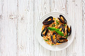 Pasta with mussels, tomato sauce and parmesan
