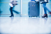 People walking in airport,Blurred Motion