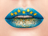 Close up view of beautiful woman lips with blue lipstick