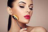 Makeup artist applies skintone with brush